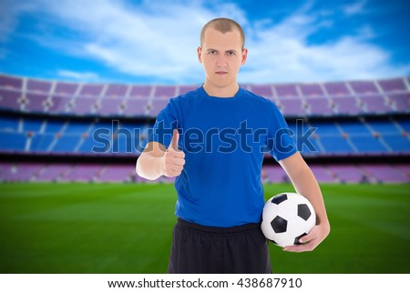 professional player with soccer ball thumbs up on the field - stock photo