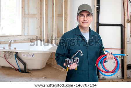 Professional plumber with a faucet. Construction concept. - stock photo
