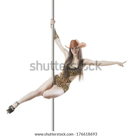 Professional poledancer girl in  leopard costume and  cowboy hat style performs tricks on a pole. White backgrond. Studio shot