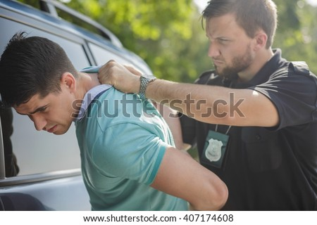 Professional police officer has to be very strong  - stock photo