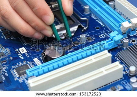 Professional repair of a circuit printed board - stock photo