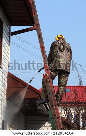 Professional roof cleaning, pressure method. - stock photo