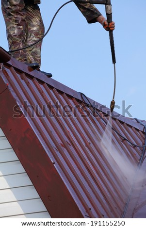 Professional roof washing. - stock photo