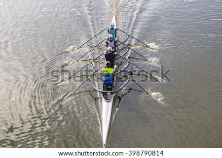 professional rowers training in a beautiful italian lake - stock photo