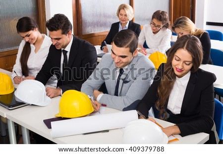 Professional russian architects having advanced training courses in classroom - stock photo
