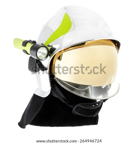 Professional safety helmet for fireman to protect him from fire.  Shiny with gold front shield. - stock photo
