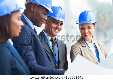 professional senior construction manager working with team - stock photo
