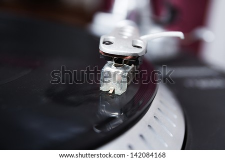 Professional sound equipment for a disc jockey. Turntable vinyl record players and 2 channel sound mixing controller. - stock photo