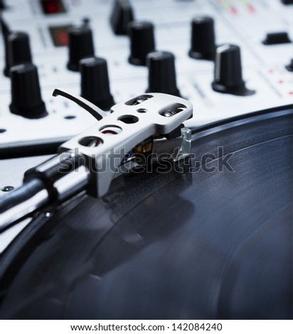 Professional sound equipment for a disc jockey. Turntable vinyl record players and 2 channel sound mixing controller.