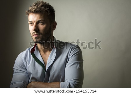 Professional studio portrait of young handsome man  - stock photo