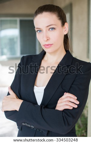 Professional successful business woman outside her office - stock photo