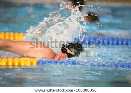 Professional swimmer crawl freestyle - stock photo