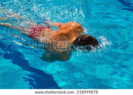Professional swimmer in the pool - Stock Image
