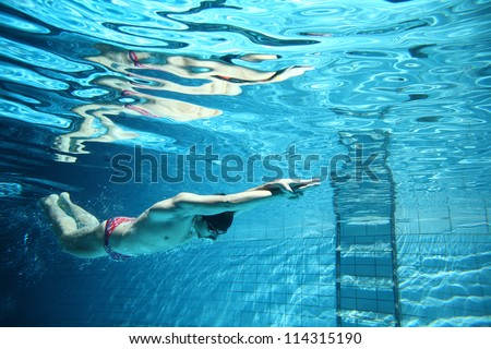 professional swimmer underwater swimming butterfly - stock photo
