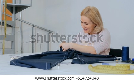 Professional tailor, fashion designer working at sewing studio. Preparation process. Fashion and tailoring concept