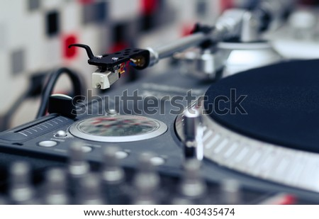 Professional turntable record player. Analog sound equipment for DJ, nightclub or audio enthusiast. Focus on the needle