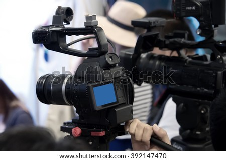 Professional video camcorder on duty - stock photo