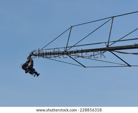Professional video camera records events of city from height of crane - stock photo