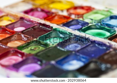 Professional watercolor aquarell paints in box with brushes (selective sharpness). - stock photo