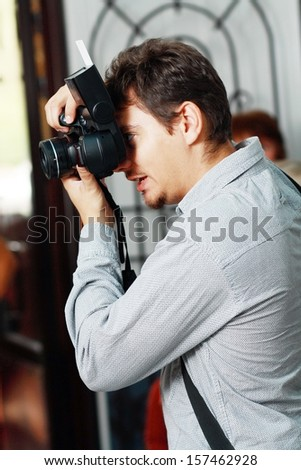 professional Wedding photographer in action - stock photo