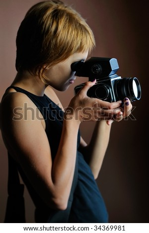 professional woman photographer in studio