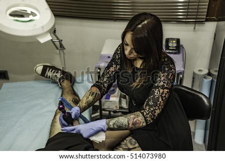 Portrait woman tattoo artist working tattoo stock photo for Working man tattoo