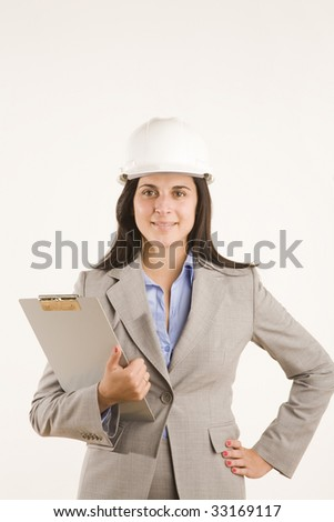 professional woman with cipboard and hard hat