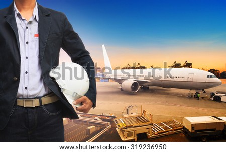 professional working man in cargo plane loading for logistic - stock photo