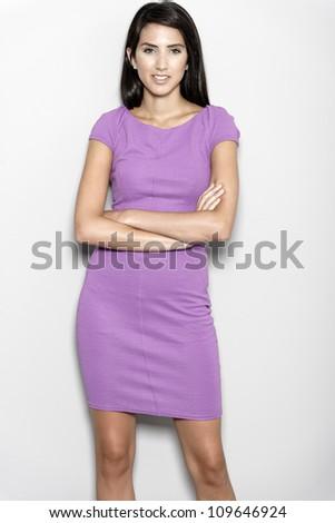 Professional working woman in corporate purple dress - stock photo