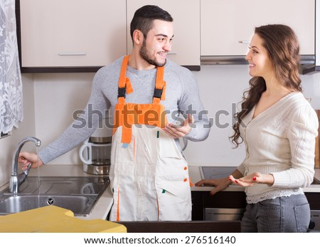 Professional workman visiting female for repairing  water lines