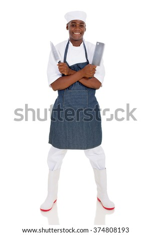 professional young african butcher holding knives on white background