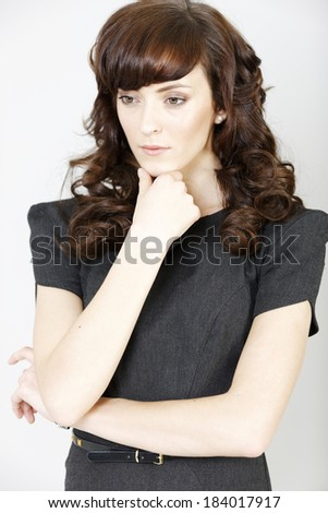 Professional young business woman looking concerned and worried.