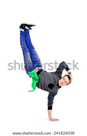 Professional young man dancer dancing hip-hop at studio. Isolated over white. - stock photo
