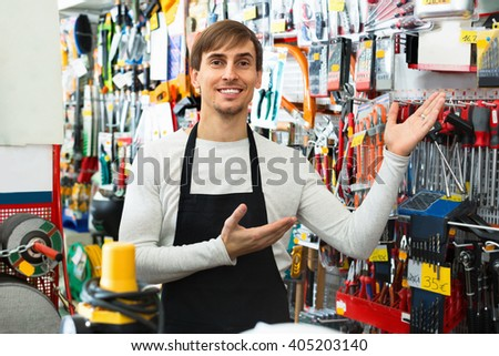 Professional young salesman working and smiling in building store