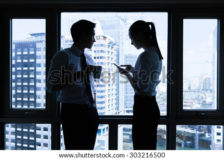 Professionals having a discussion in a office setting.  - stock photo
