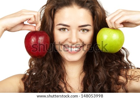 Professionaly retouched HD full-frame capture. Beautiful brunette holding apples