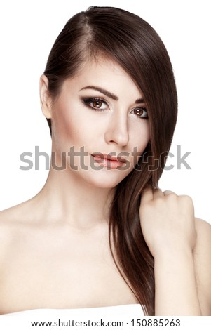 Professionaly  retouched studio HD capture of a beautiful young brunette woman touches her hair on white background