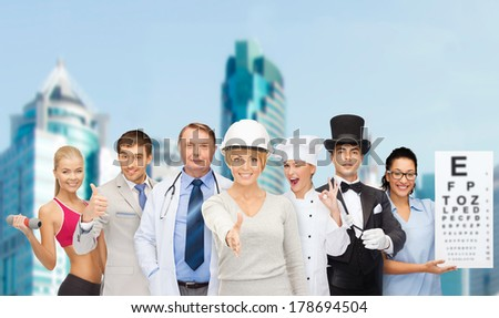 professions and people concept - group of people including businessman, cook, doctor, architect, nurse, magician and personal trainer - stock photo