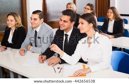 Professor and positive professionals at extension business courses - stock photo
