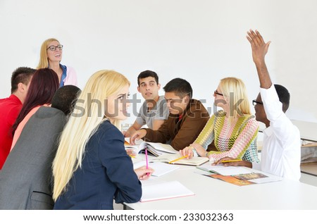 Professor examines a group of young students, black, white, Chinese and girls, hands up