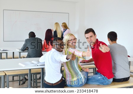 Professor shows a group of young students, black, white, Chinese and girls in lectures, finger up