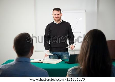 Professor teaching a graphic,Italy - stock photo