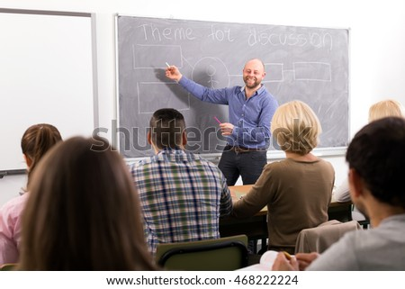Professor teaching different age students at extension courses