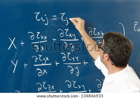 Professor teaching with blackboard