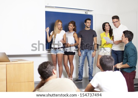 professor with students making a presentation