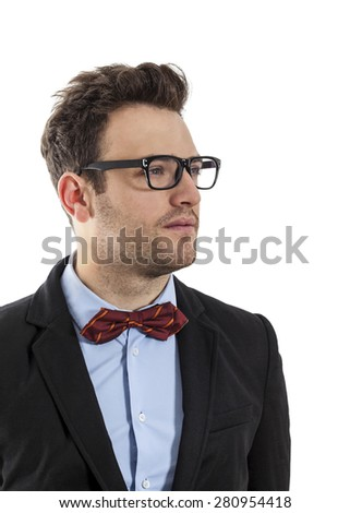 Profil of a young businessman with a red bow and spectacles, against a white background. - stock photo