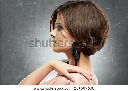 profile face portrait of sexy woman with medium length hair . bob haircut. big black earring. - stock photo