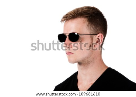 Profile head shot of a young handsome man wearing sun glasses isolated on a white background. - stock photo