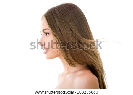 Profile of a beautiful woman with long hair - stock photo