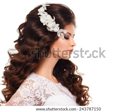 Profile of a beautiful young brunette girl in white lace wedding dress  and luxury accessories isolated on white background